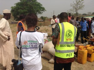 Nike and Mr Isa of FEMA viewing donated relief materials