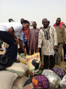 The 'camp' leader receives food items on behalf of those in need