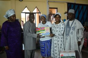 Sesor's Executive Director and Betty Abah handing over materials to the church's Welfare Committee for the IDPs