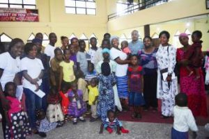 Sesor Team, Tee A and Betty A pictured here with some of the displaced women and children